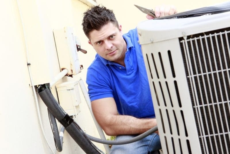 man checking ac